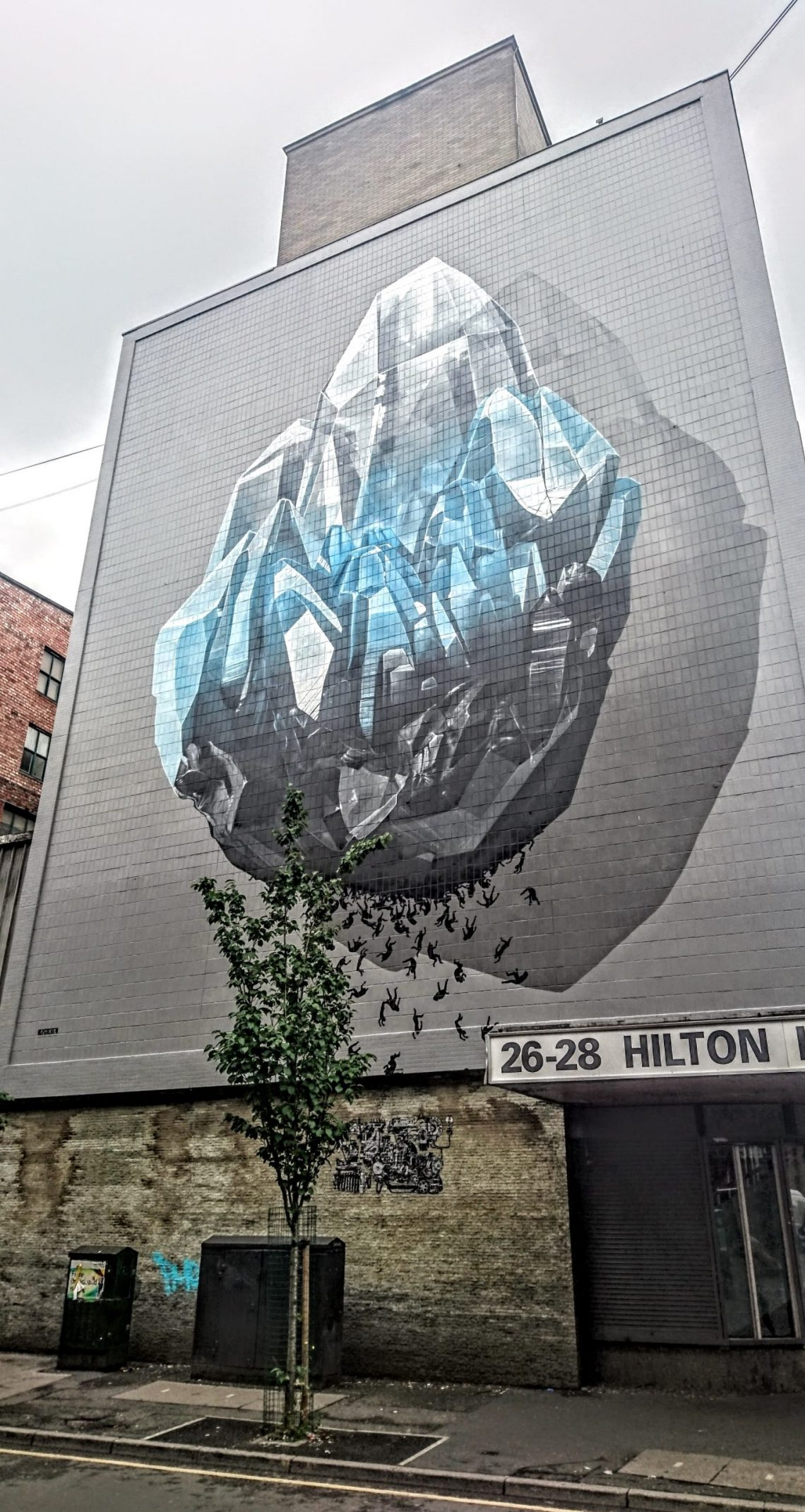 The mural by Never Crew on Tariff Street. This was painting as part of Manchester's Cities of Hope Festival