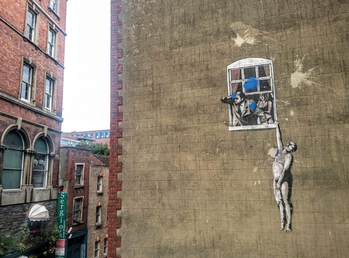 hanging man banksy bristol hill street
