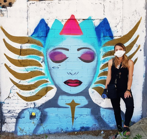 Photograph of street artist Audifax taken by a wall in the Poblenou area of Barcelona