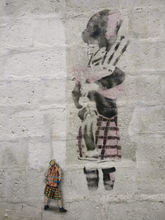 An older stencil from Elki featuring a bagpipe player with a later cheeky addition from Jaune