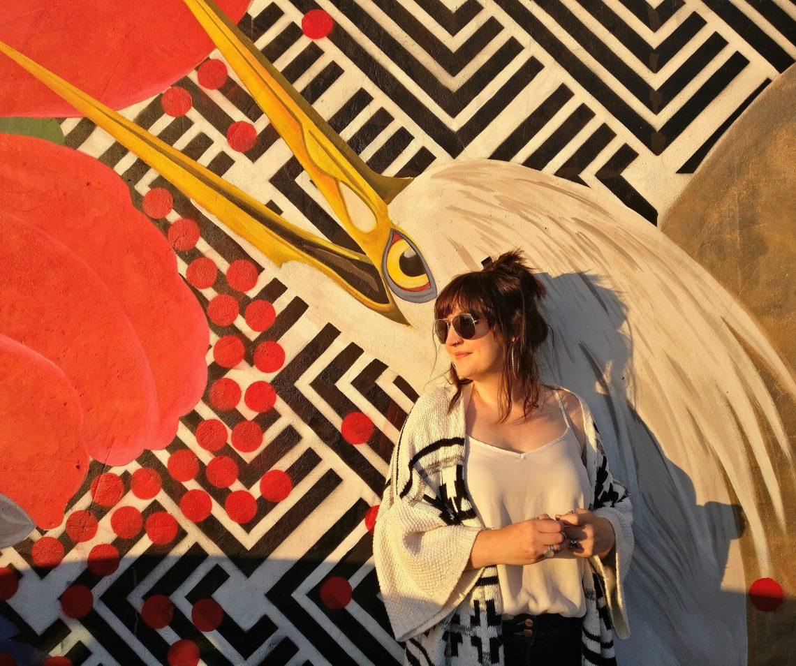 Artist Alexandra Gallagher by her mural at Blackburn Open Walls
