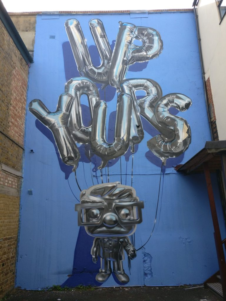 Large mural by Fanakapan on Brick Lane. He is one of our best british street artists