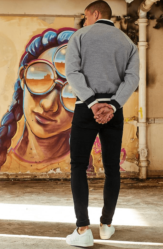 Part of the campaign from the BoohooMAN website. This image features artwork from Irony