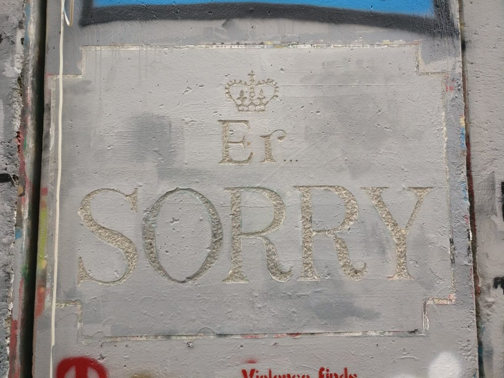 Banksy's 'Er... Sorry' artwork on the separation barrier in Bethlehem