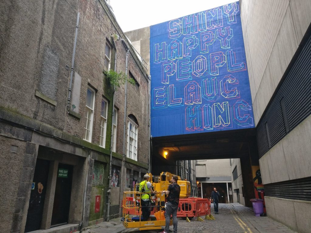 Shiny Happy People Laughing by Ben Eine for Nuart Aberdeen in 2019