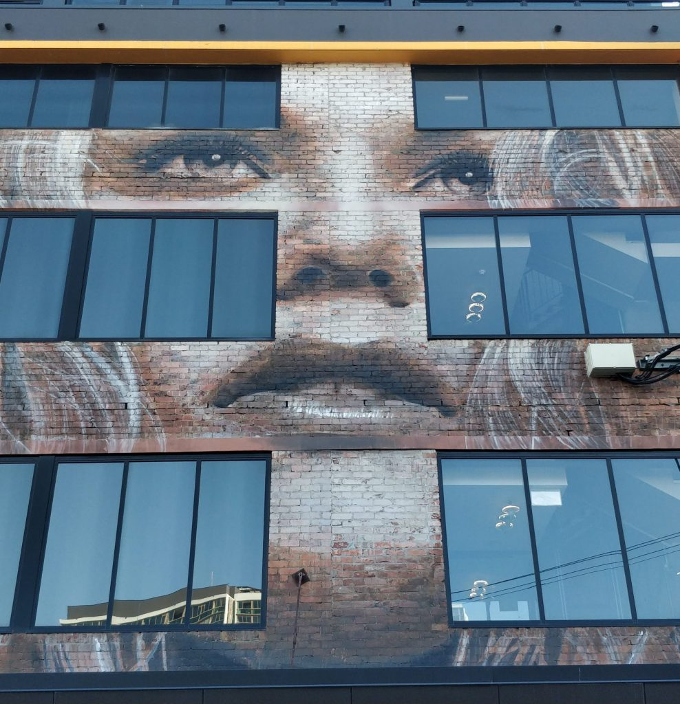 A mural by rone on the side of the Tryp Street Art Hotel in Brisbane