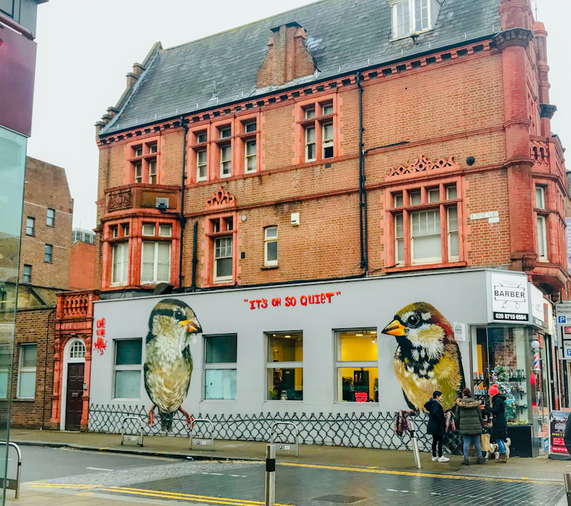 Sparrows street art in Wimbledon by Louis Masai. Sparrows are number one in the 2020 RSPB Big Garden Birdwatch