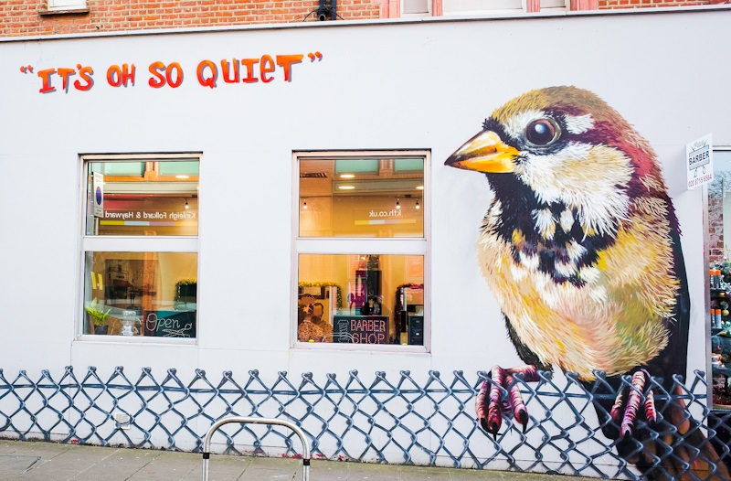 'It's oh so quiet' the sparrow mural in Wimbledon by Louis Masai