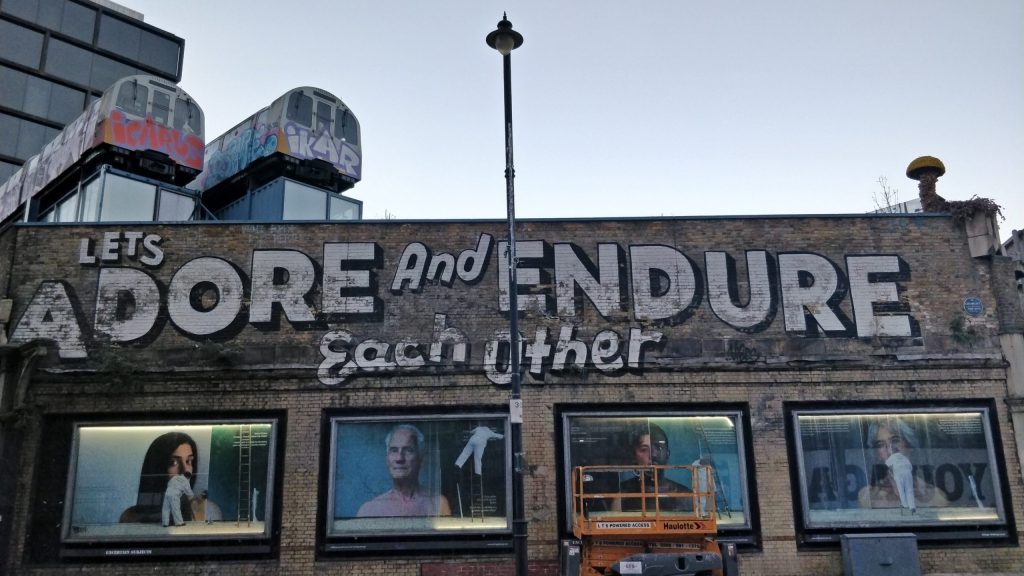 Adore and Endure Each Other. A famous mural on Great Eastern Street in Shoreditch