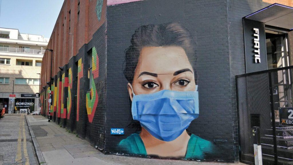 Nurse with a facemask in Shoreditch, London. Coronavirus street art