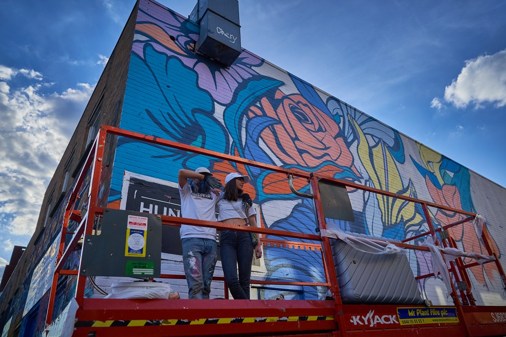 Nerone and his partner Frankie by the completed mural on Chance Street
