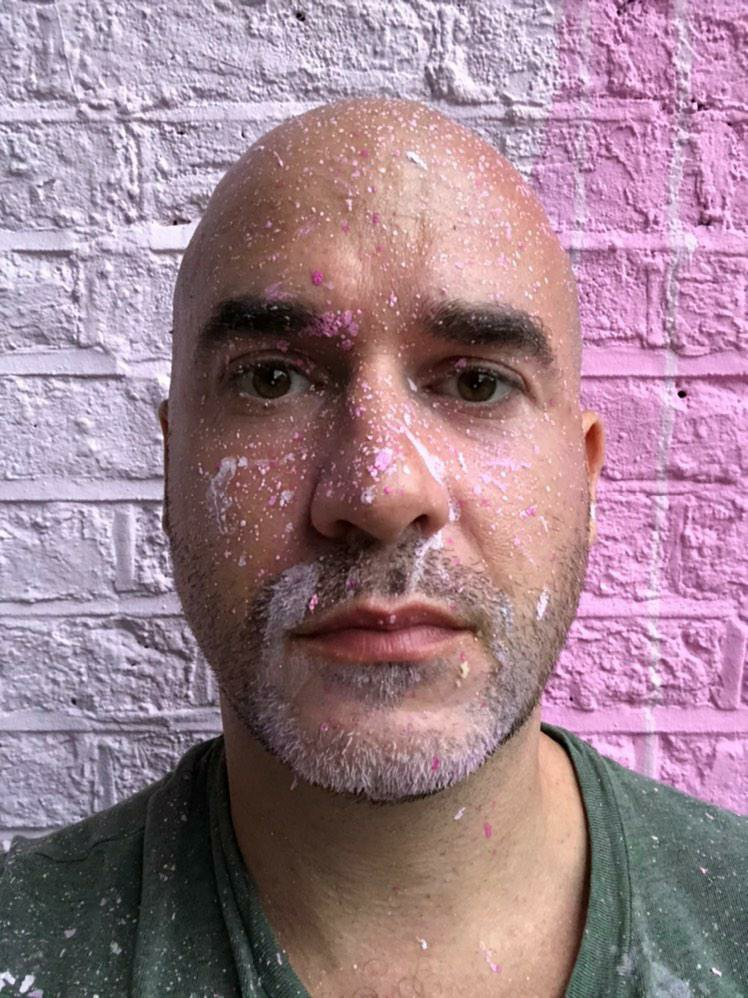 The artist Paul Robinson covered in paint