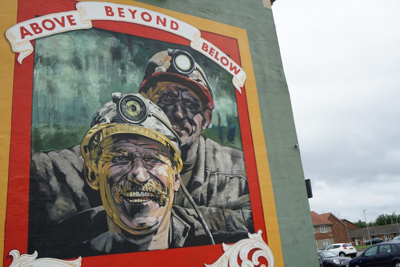 Miners shown on the Above Beyond Below Mural in Seaham