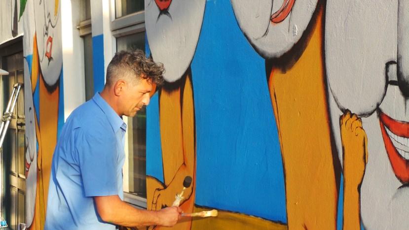 Artist Giacomo Bufarini painting at the London Mural Festival