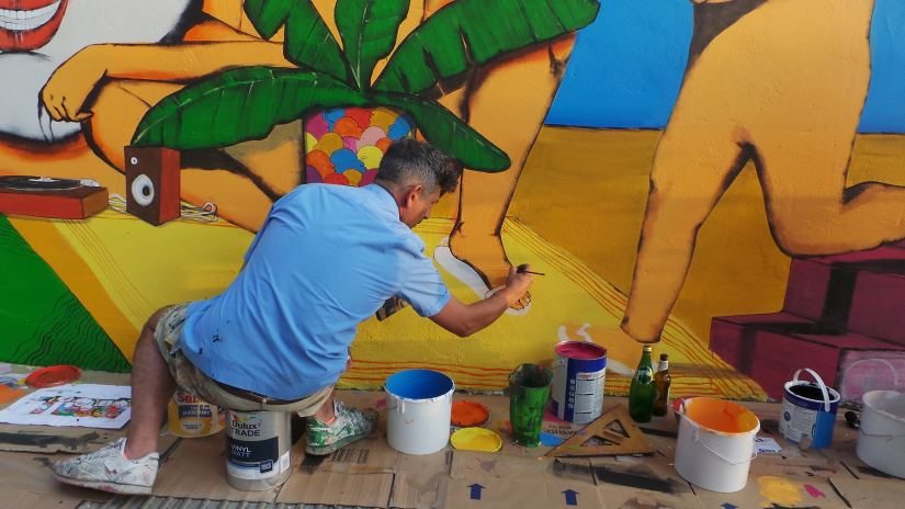 Giacomo Bufarini painting as part of the London Mural Festival in Clapton
