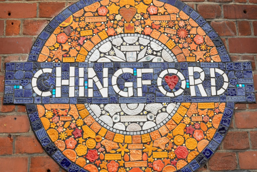 Close up of the Chingford station mosaic roundel