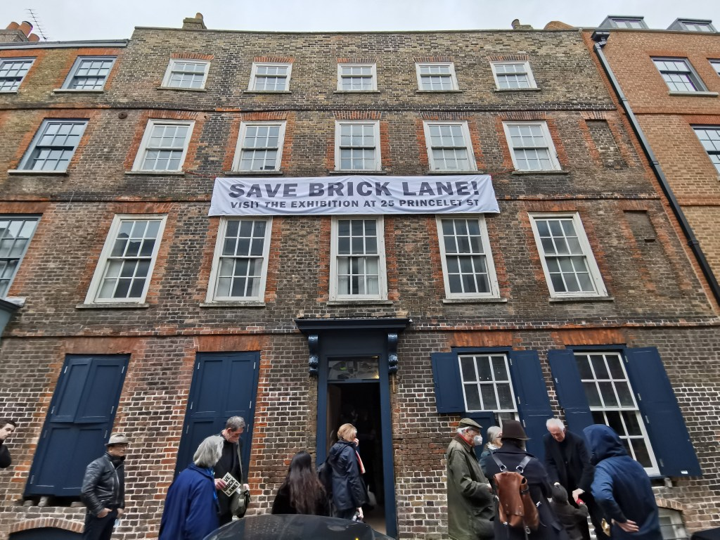 Exterior of 25 Princelet Street showing people at the launch of the save brick lane campaign