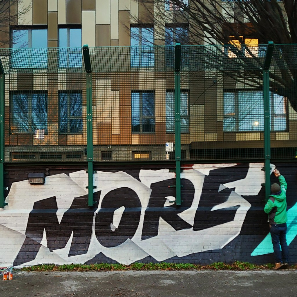 The word 'More' painted by graffiti artist Coma