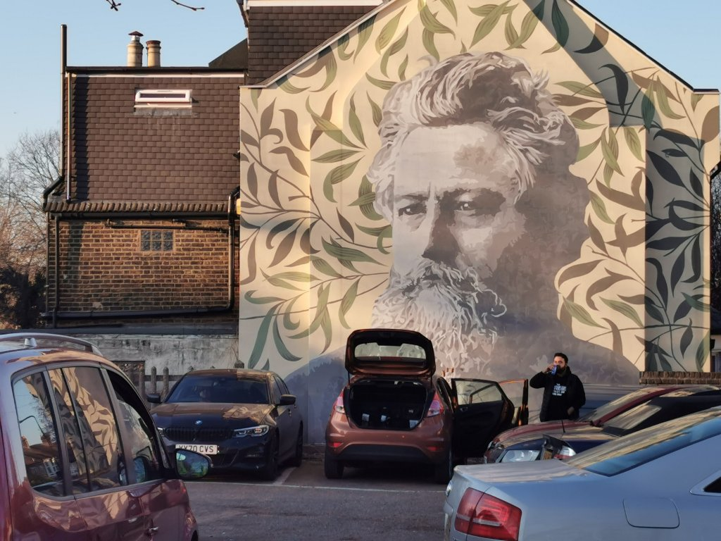 Street art mural of William Morris by ATMA in Walthamstow.