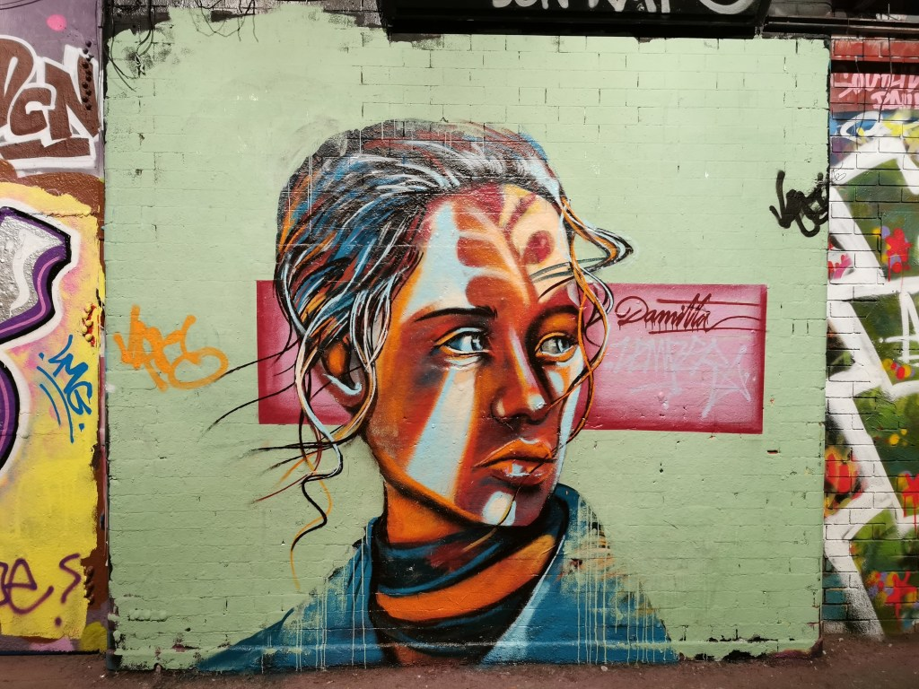 Portrait of a woman in the Leake Street Tunnel by Damitta