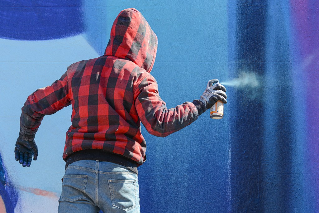 An image of the French street artist Nerone with a spray can