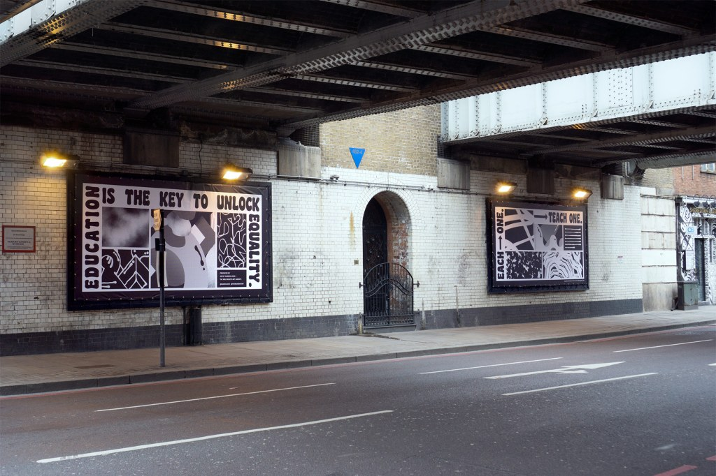 Education is the key to unlock equality posters underneath a bridge on Old Street