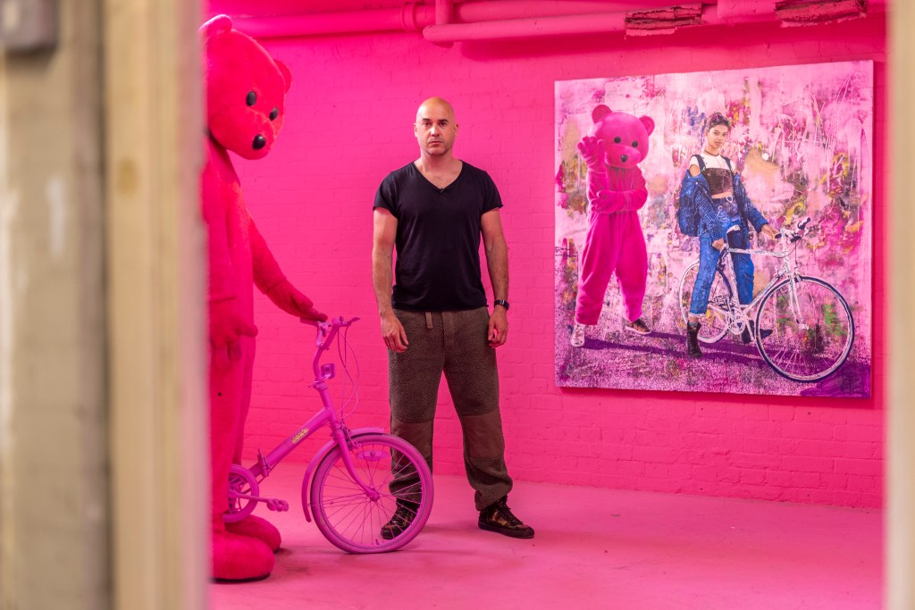 Artist Paul Robinson in his pink room at the Fulham Town Hall