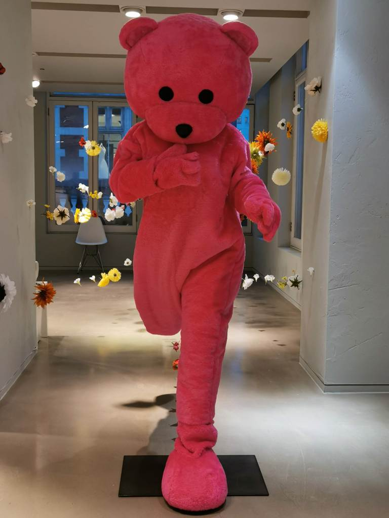 A giant installation of a pink bear running. The installation is part of the LUAP exhibition the Unconscious Therapy