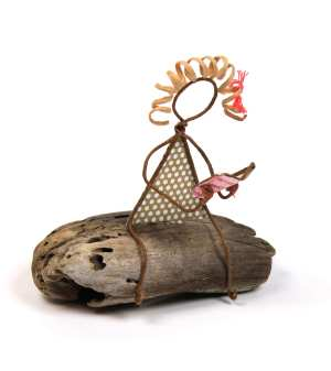 Image of Quiet Solitude, a sculpture in wire and cut paper on driftwood.