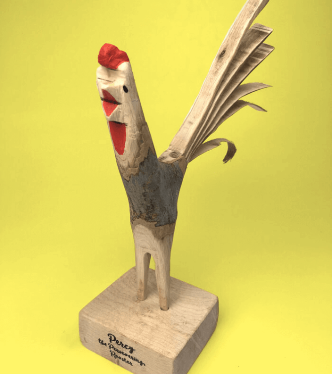 Percy, the persevering rooster is hand-carved from wood and crows at the impending day. Acrylic painted accents.
