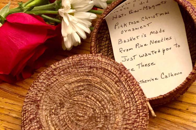 Photo of a hand-woven pine needle basket that Emmaline gifted to Patti.