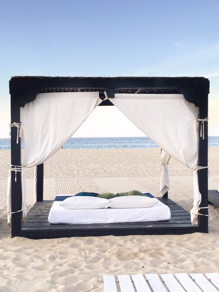 relaxing on the cabana bed on the beach Los Cabos