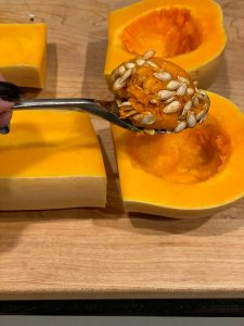 scooping out the seeds from squash