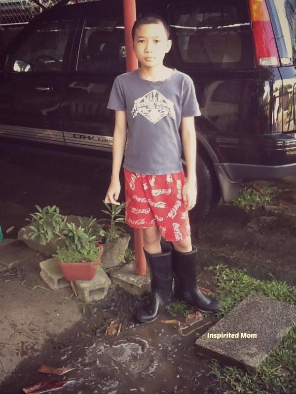 wearing his Papa's rain boots