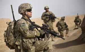 Soldiers from the U.S. Army go on patrol near Command Outpost AJK in Maiwand District, Kandahar Province