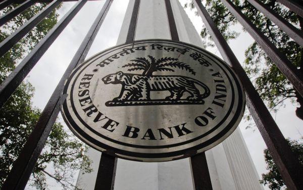 The Reserve Bank of India logo is pictured outside its head office in Mumbai