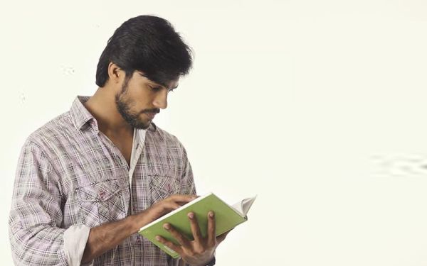 man reading  novel