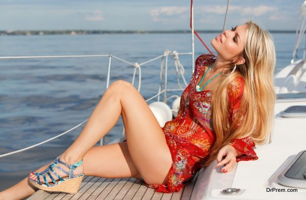 picture of sexy young woman sitting on the yacht