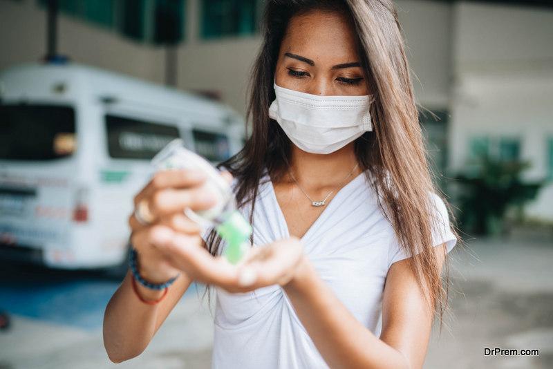 woman using sanitizer