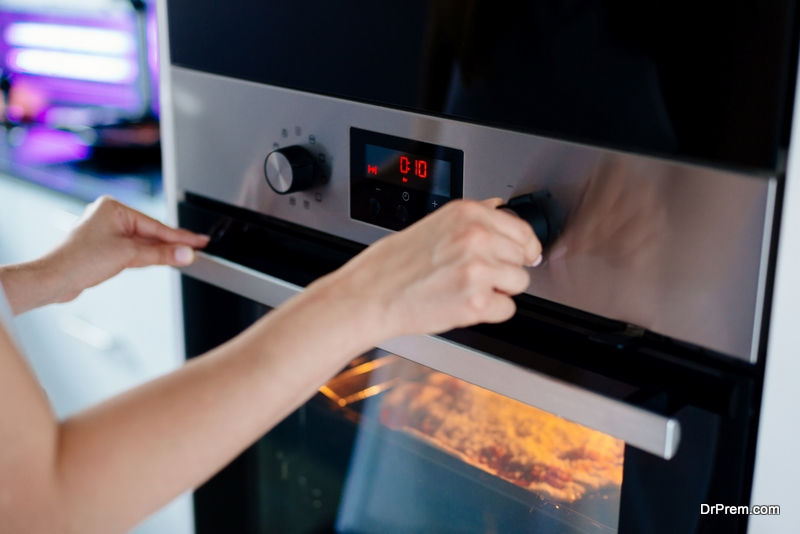 woman using the oven