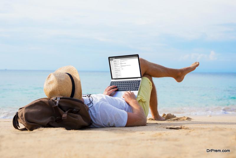 man using laptop during travel