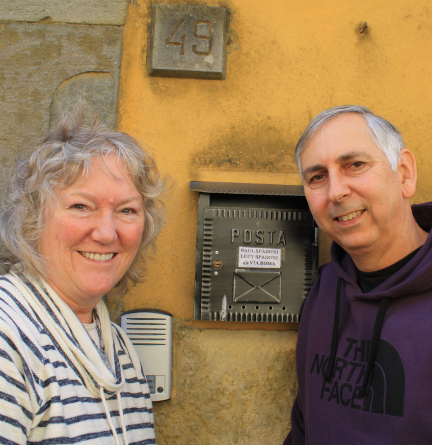 Paul and Lucy in front of their house in Montecarlo, Tuscany