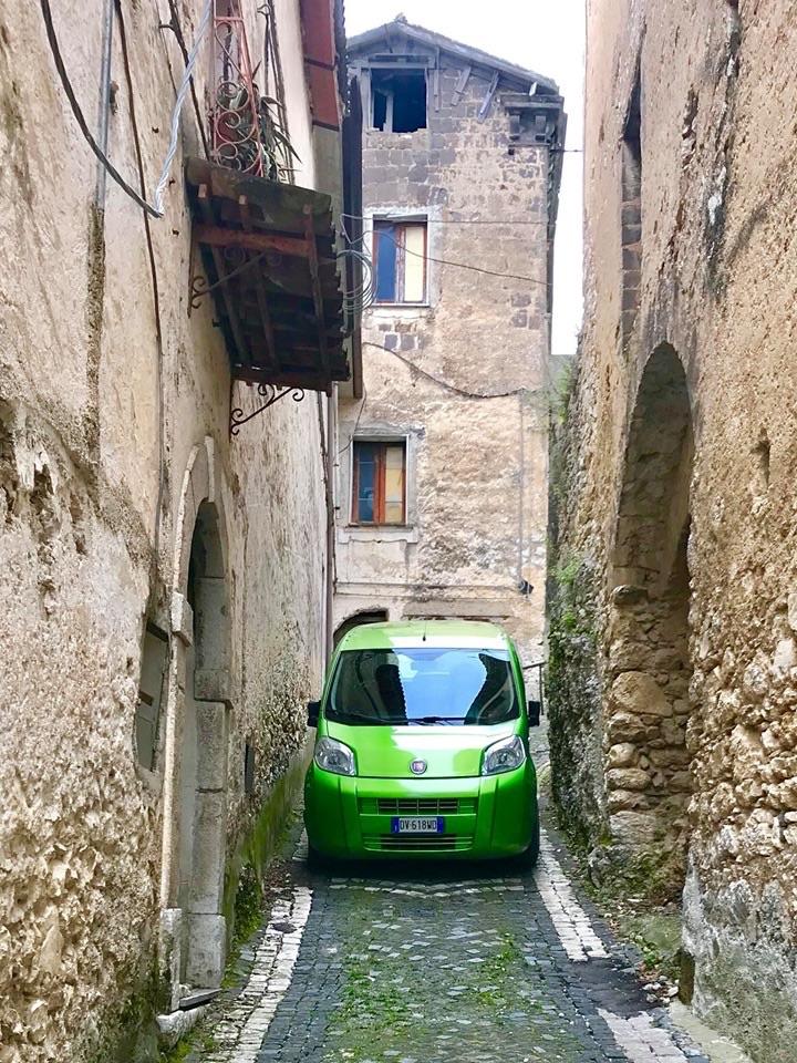 Life in Italy, a tiny car in a tiny road