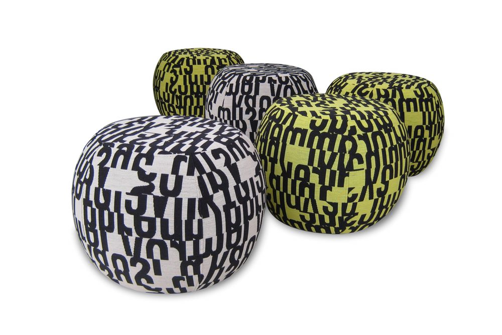 PUMPKIN Ottoman in a bold patterned fabric.