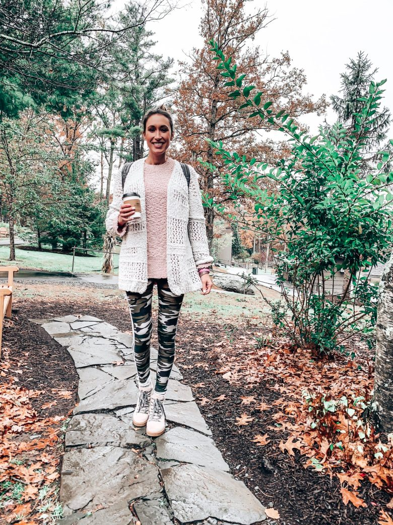 Cozy fall outfit with a pink sherpa pullover from Amazon, chunky knit cardigan, and camo leggings