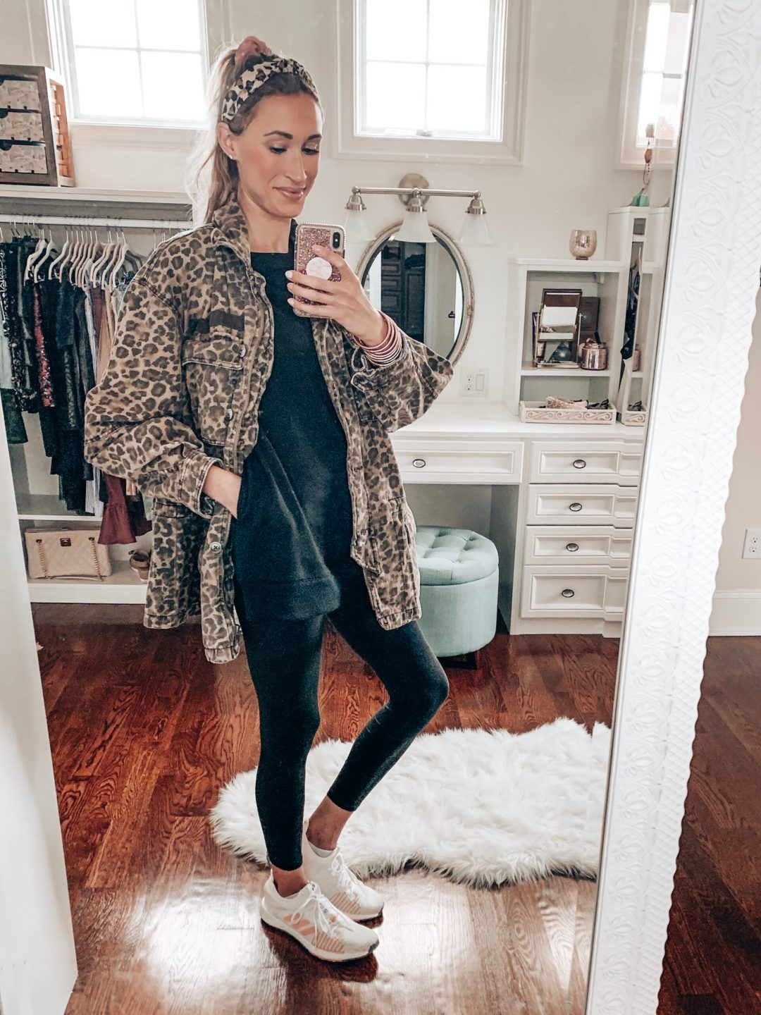 Cute fall outfit/winter outfit with a leopard print Free People jacket, Target tunic fleece sweatshirt, and black leggings