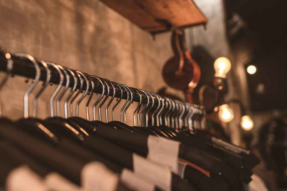 photo of black clothes on hangers