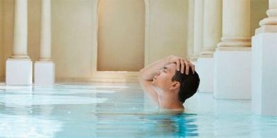 Man relaxing in a spa (image via Depositphotos)