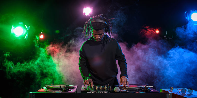 Stock photo of DJ spinning turntables