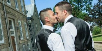 Gay couple kisses after wedding